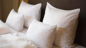 Bed with white pillows, close-up