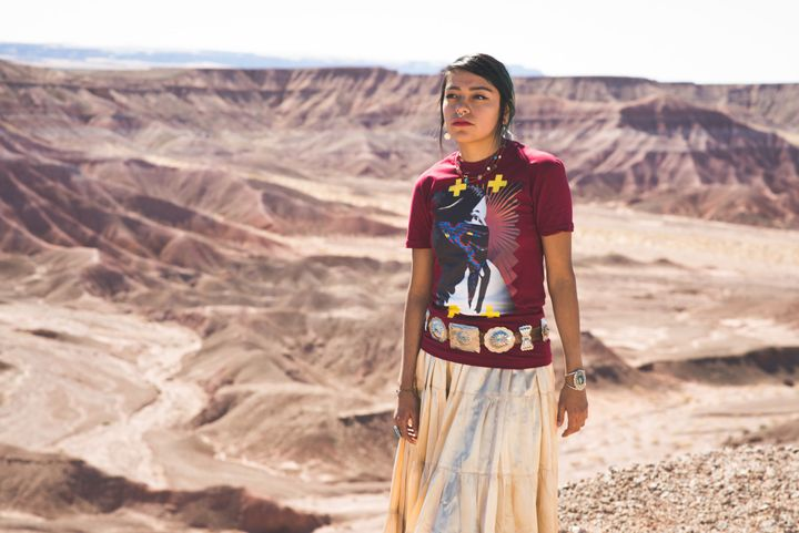 "MT Garcia is pictured wearing €""Native Protest."""
