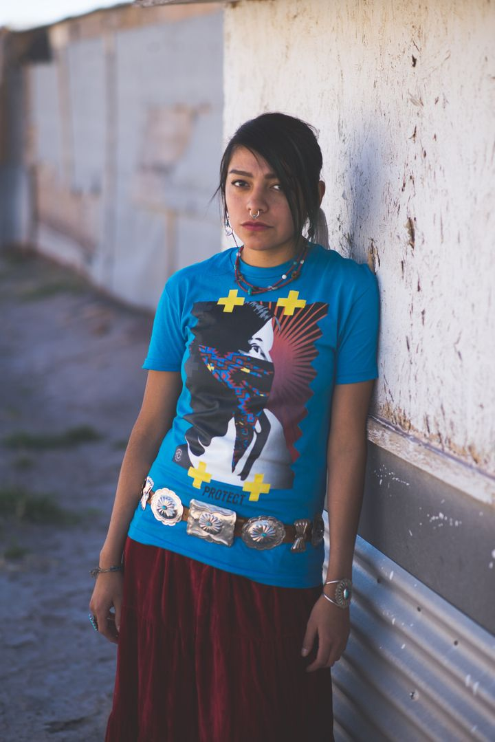 "MT Garcia is pictured wearing ""Native Protest."""