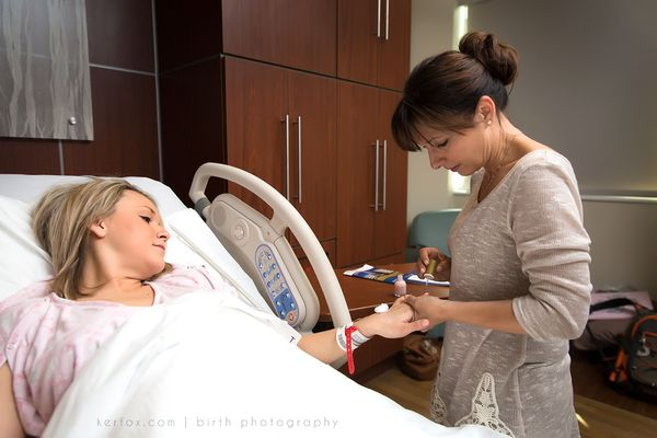 Mom paints her daughter's nails in the delivery room.