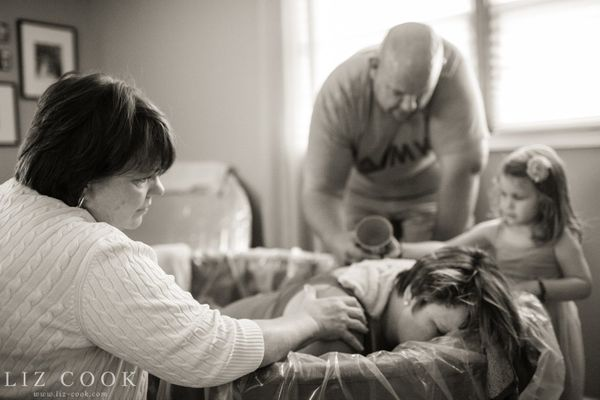 The whole family helps this mom in labor.