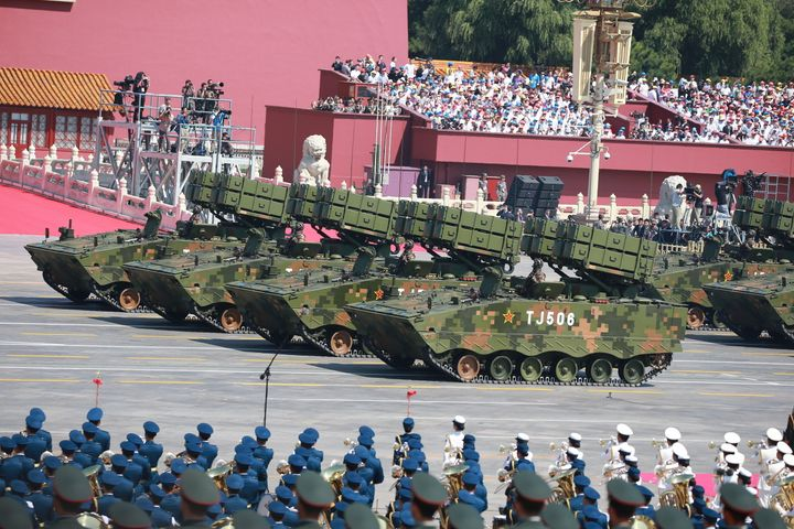 Military vehicles carrying anti-tank missiles drive across Tiananmen Square at a military parade in Beijing. The co