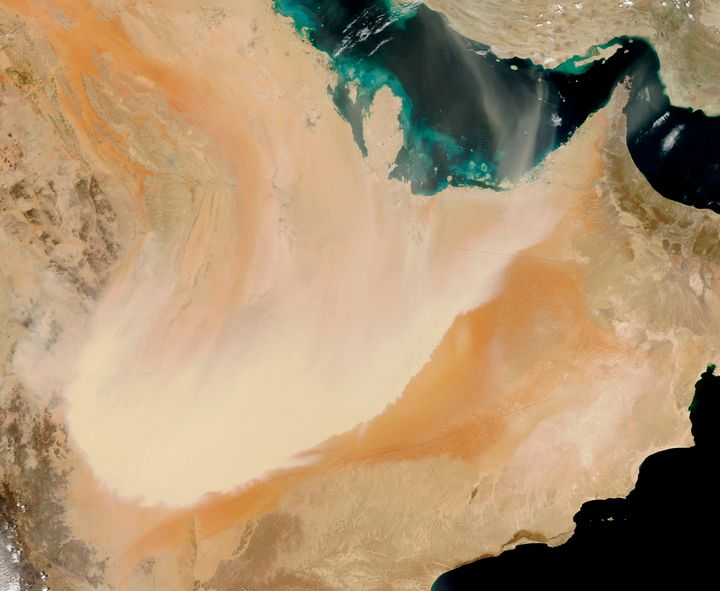A dense wall of dust barrels across the Arabian Peninsula.