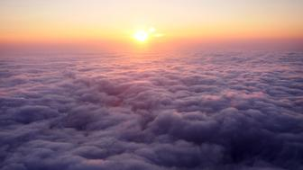 A clear sunset over cloud cover above London.