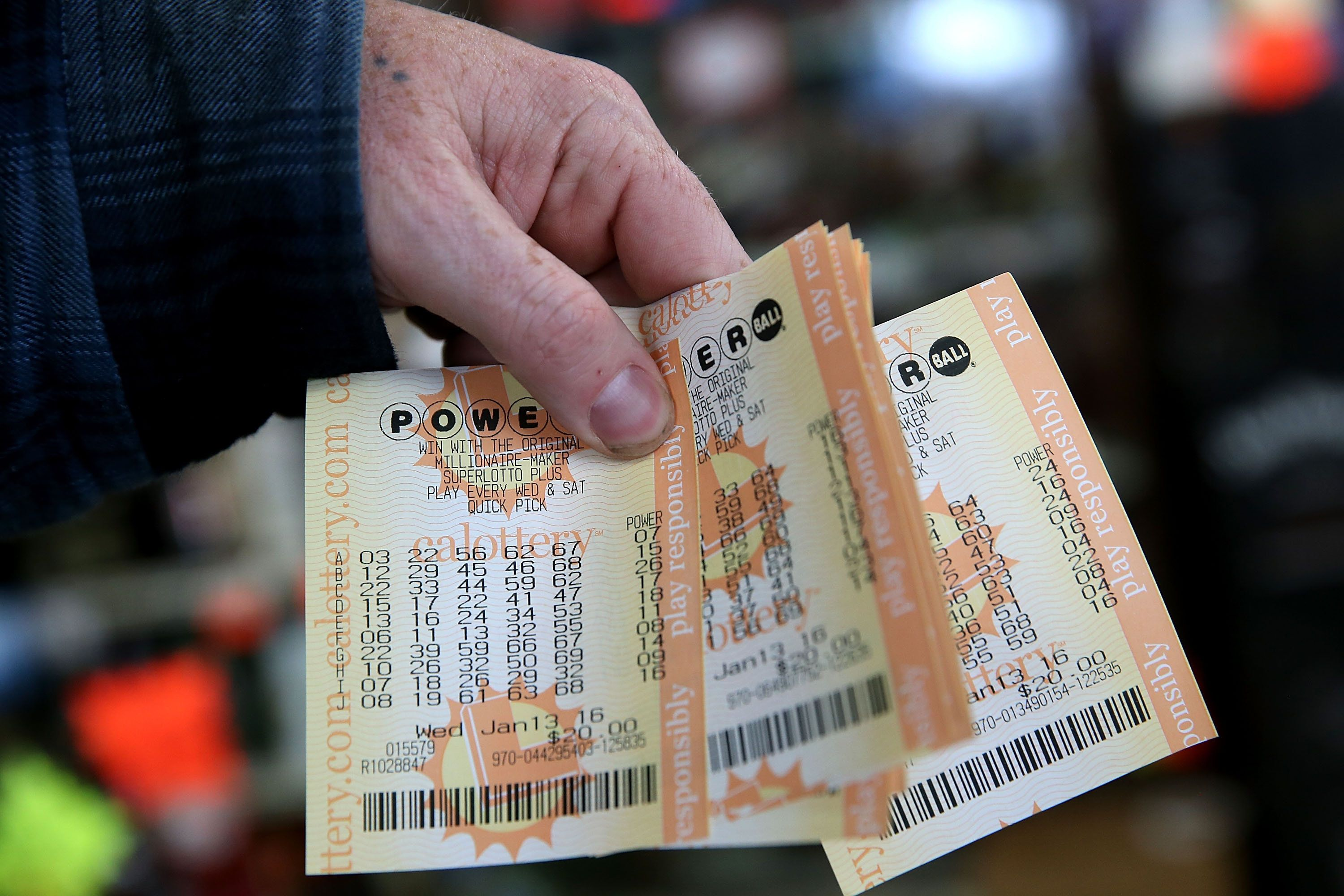SAN LORENZO, CA - JANUARY 13:  A customer holds a handful of Powerball tickets at Kavanagh Liquors on January 13, 2016 in San Lorenzo, California. Dozens of people lined up outside of Kavanagh Liquors, a store that has had several multi-million dollar winners, to -purchase Powerball tickets in hopes of winning the estimated record-breaking $1.5 billion dollar jackpot.  (Photo by Justin Sullivan/Getty Images)