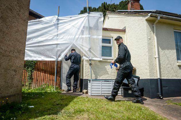 Police enter the former home of David and Pauline