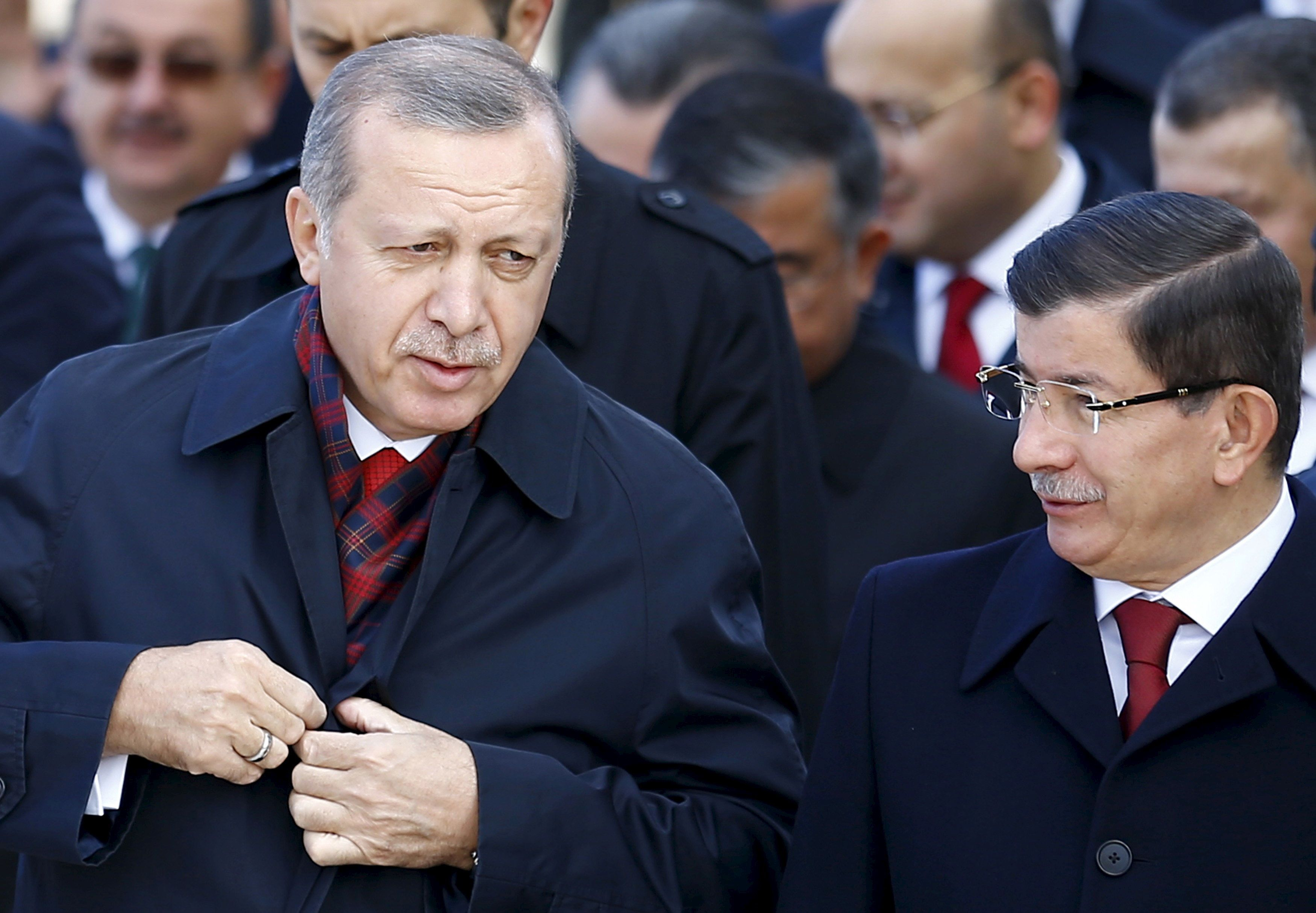 Turkey's President Tayyip Erdogan (L) chats with Prime Minister Ahmet Davutoglu during a Republic Day ceremony at Anitkabir, the mausoleum of modern Turkey's founder Ataturk, in Ankara, Turkey, October 29, 2015. Turkey marks the 92nd anniversary of the Turkish Republic. REUTERS/Umit Bektas