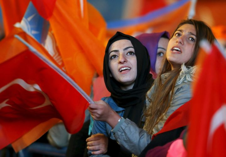 Women wave flags outside AK Party headquarters in Ankara on Nov. 2, 2015. The AK Party regained its parliamentary majority in