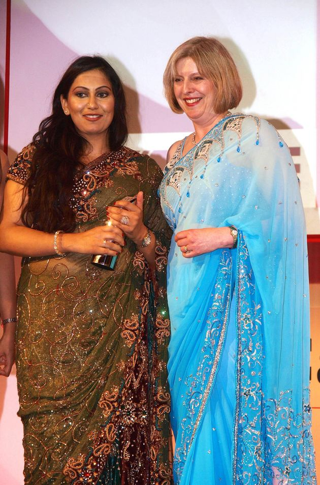 Shazia Awan (left pictured withHome Secretary Theresa May) called Goldsmith's campaign 'vile, repulsive...