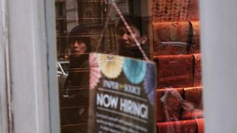 NEW YORK, NY - MARCH 04:  A Now Hiring sign hangs in a window in lower Manhattan on March 4, 2016 in New York City. In another sign that the US economy continues to show growth, the government reported on Friday that employers added 242,000 workers in February.  (Photo by Spencer Platt/Getty Images)