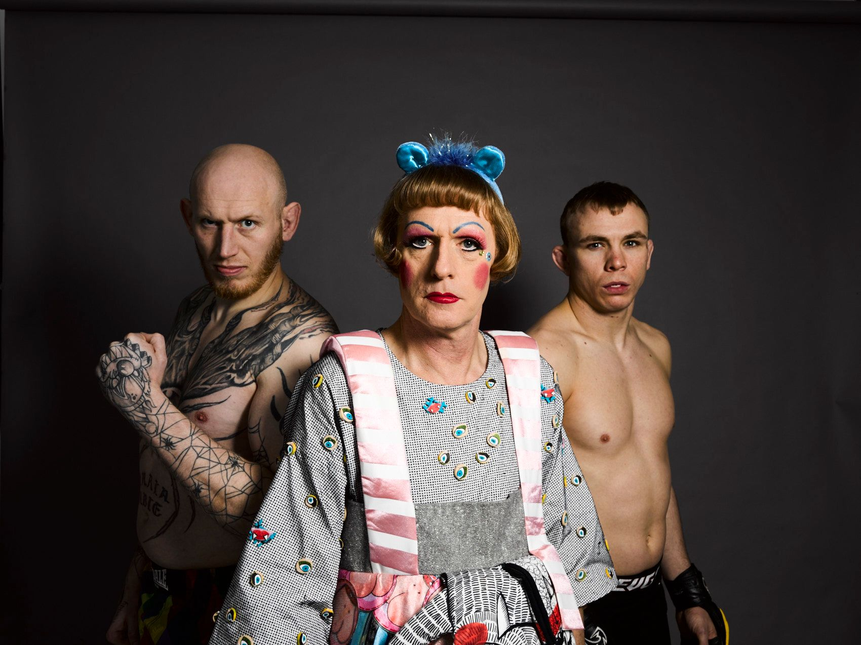 Grayson Perry as Claire with two cage