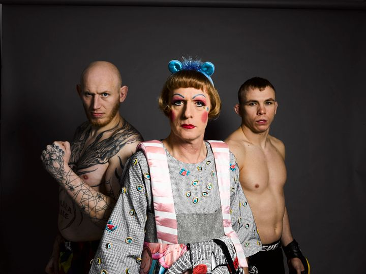 Grayson Perry as Claire with two cage fighters