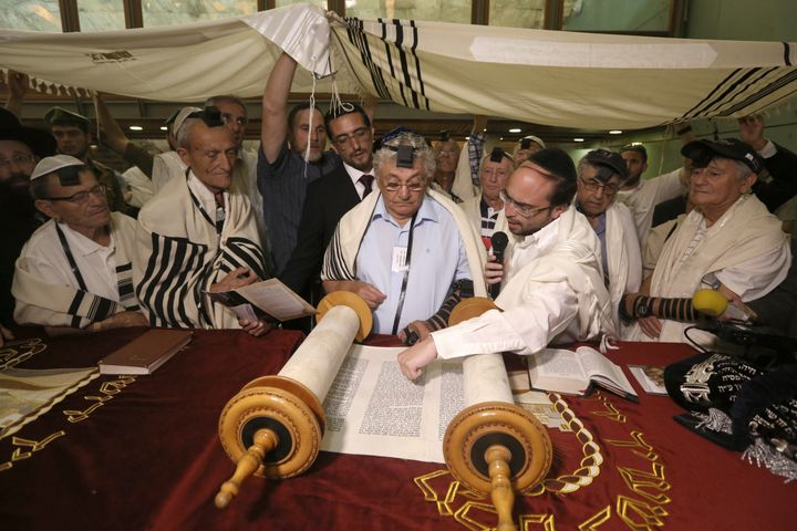 Dozens of Jewish holocaust survivors read from the Torah scrolls during the ceremony.