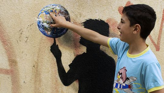 A Street Artist Leaves His Mark On Jordan's Refugee