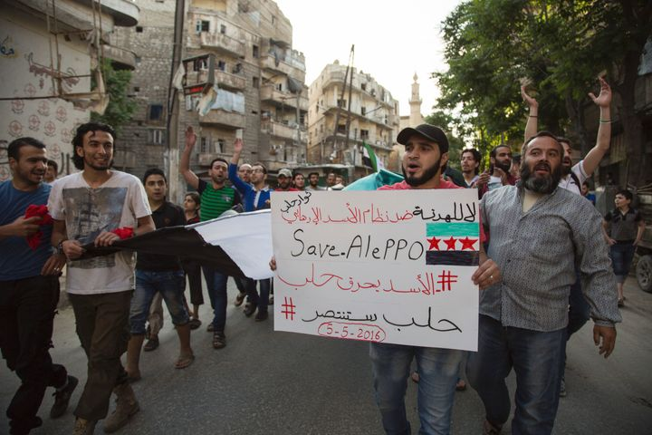 The city of Aleppo has borne the brunt of the fighting. Above, Syrians protest in a rebel-held district of Ale