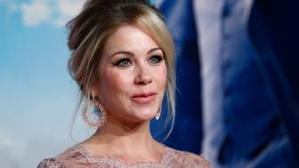 Actress Christina Applegate poses at the UK Premiere of the film Anchorman 2 in Leicester Square, London, December 11, 2013. REUTERS/Andrew Winning  (BRITAIN - Tags: ENTERTAINMENT)