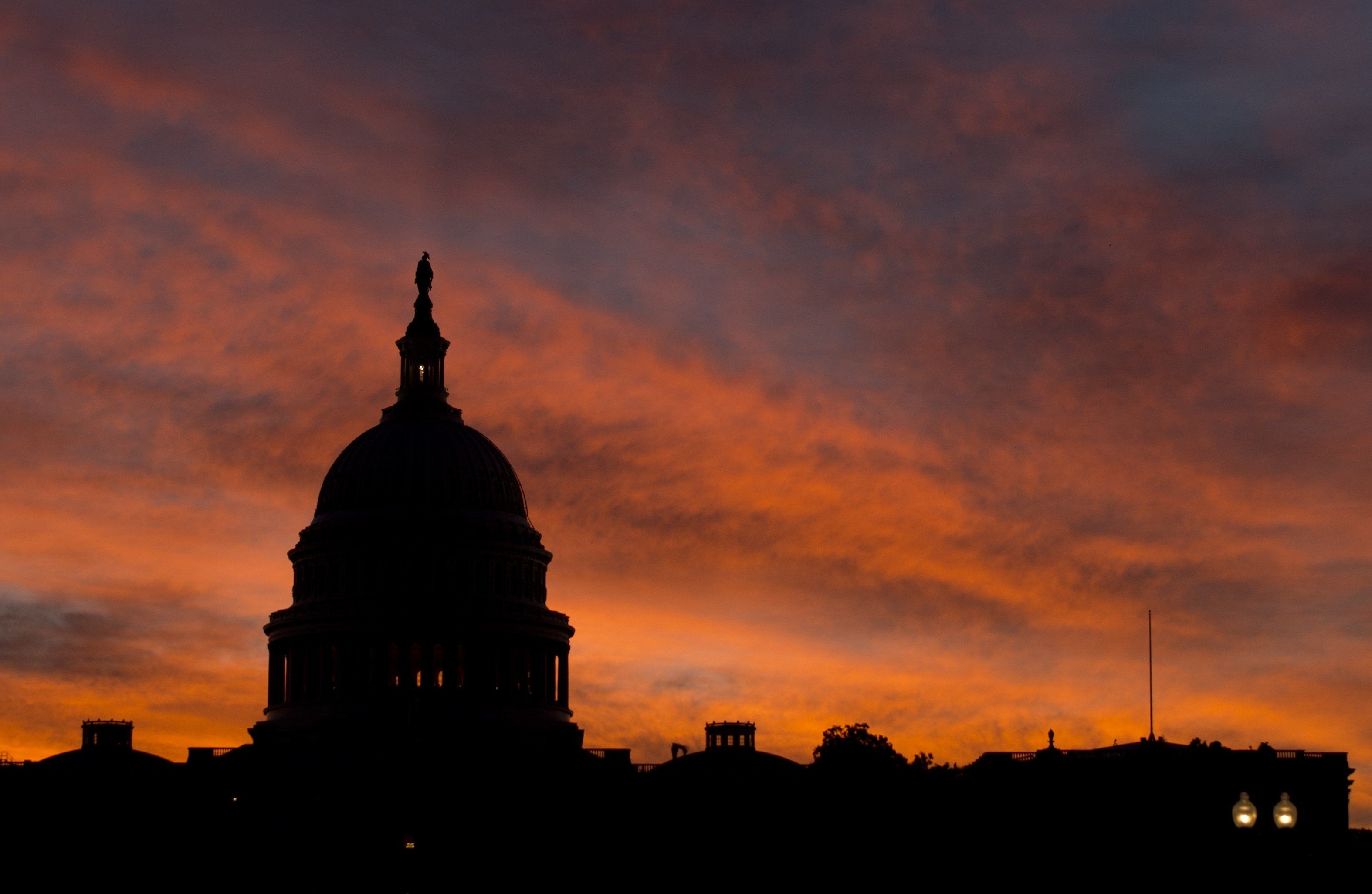 The US Capitol dome is seen at sunrise over Washington, DC, September 25, 2013. The US Senate faces a Sunday showdown over whether to keep government running, but bickering over US President Barack Obama's signature health care law is bringing federal agencies dangerously close to a shutdown. A fractured Congress is struggling to approve a stopgap spending bill that keeps government doors open after the current fiscal year ends next Monday. AFP PHOTO / Saul LOEB        (Photo credit should read SAUL LOEB/AFP/Getty Images)