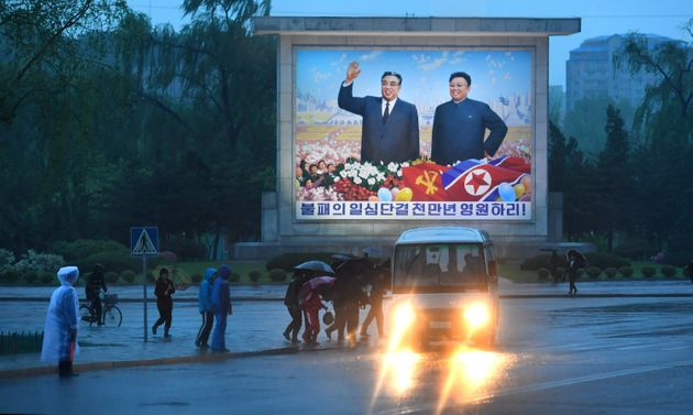 The late Kim Il-sung and his son Kim Jong-il are seen on a sign in Pyongyang, North Korea, on May 3....