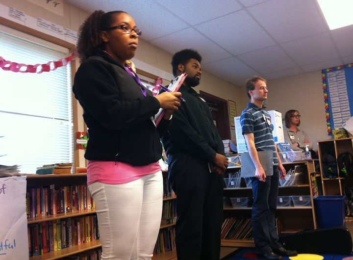 Graduate students observe as a classmate delivers a lesson about similes and metaphors to a fifth-grade class at Adams Elemen