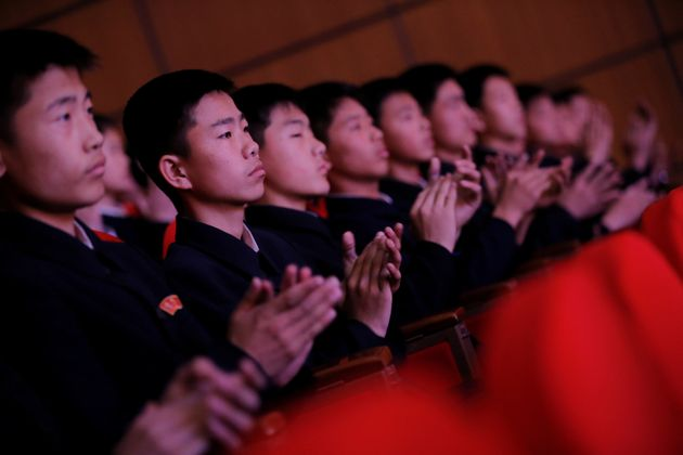 Spectators clap hands during a performance at the Mangyongdae Children's Palace in central Pyongyang,...