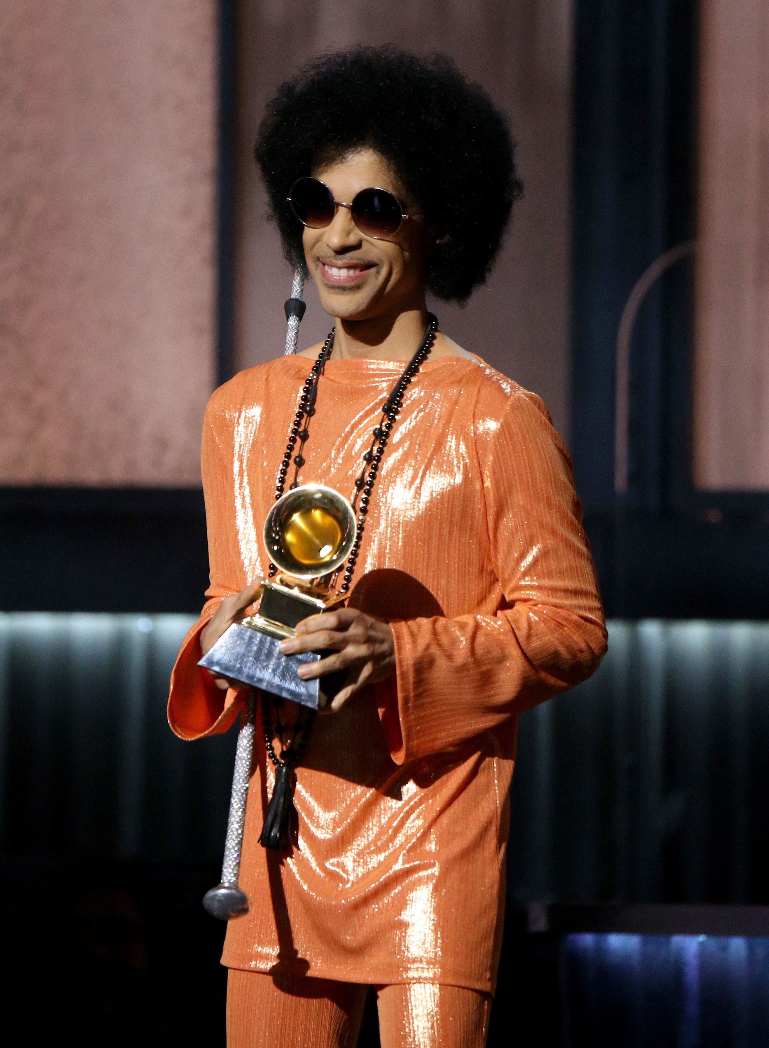 Prince speaks onstage during the Grammy Awards in 2015 in Los