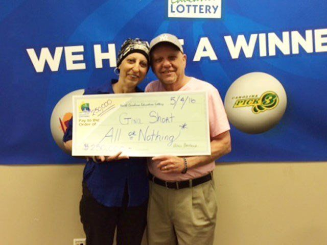 Gina Short, with her husband Len, beat the 1 in 2.7 million odds of winning the $250,000 prize.