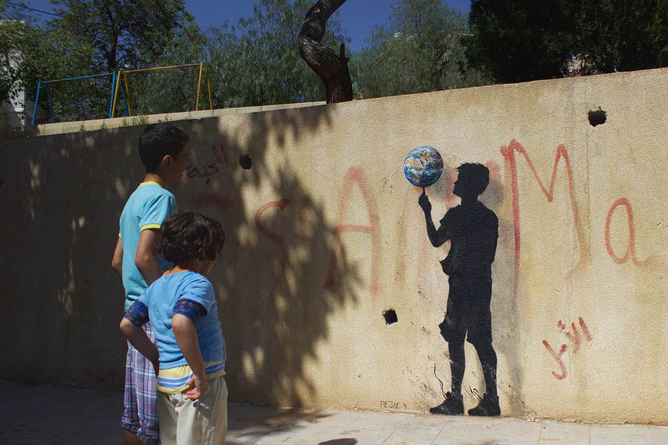 An artwork titled Rotation in the Jabal Al Webdah neighborhood, Amman.