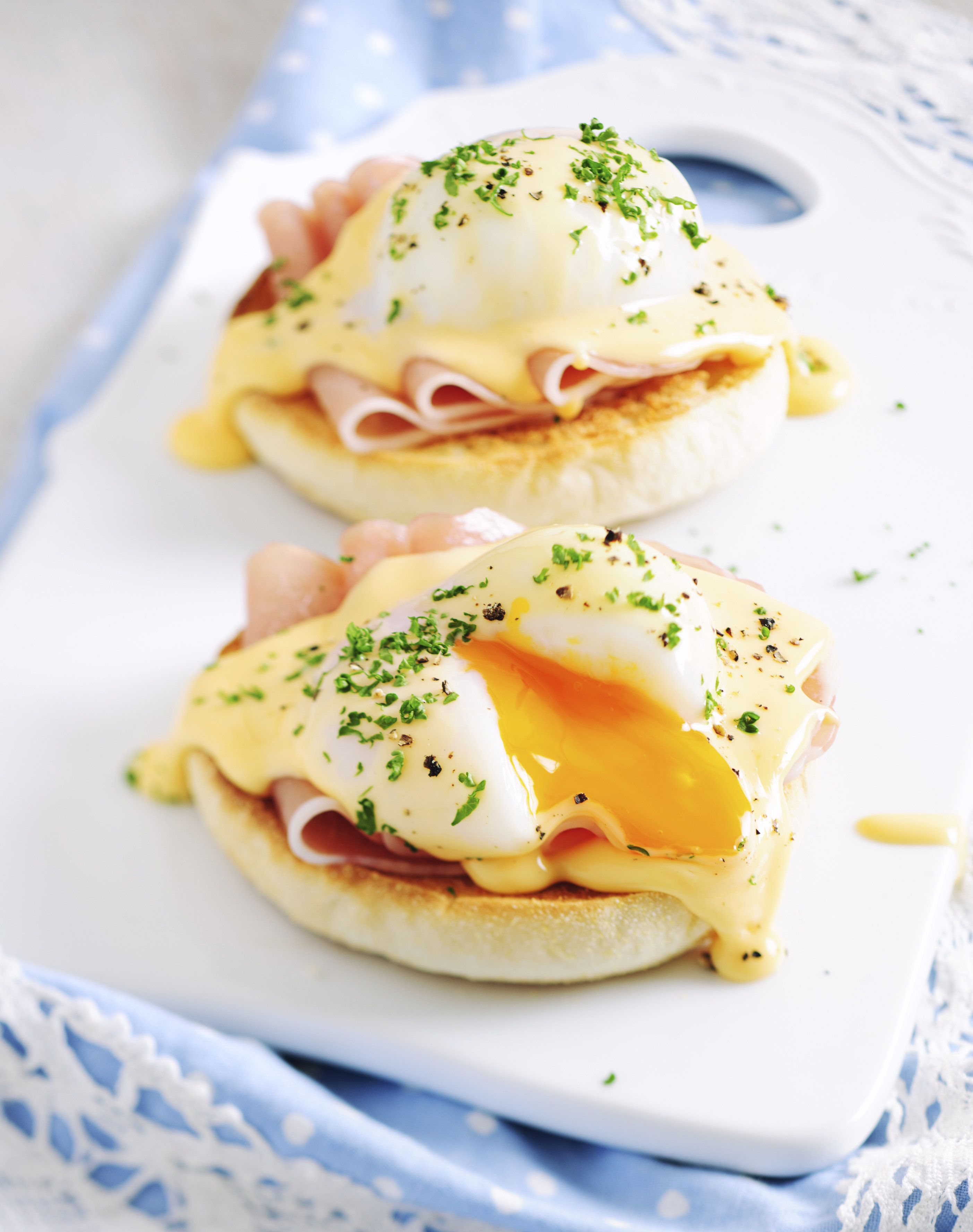 Eggs Benedict Sandwiches Served on Porcelain Board. Selective Focus, Shallow DOF, Tilt&Shift Lens Used