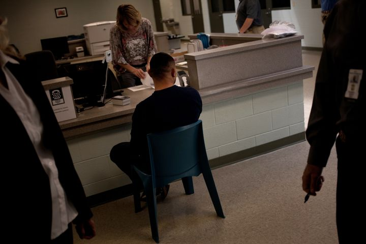 A detainee undergoes processing at what was then known as Karnes County Civil Detention Center on Sept. 9, 2013. The Tex