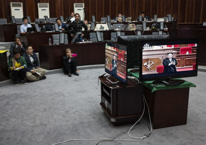 Foreign journalists invited to cover the event were not permitted inside the congress.Here, journalists watch a televis