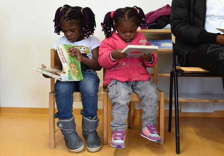 Refugee children from Nigeria read books during a first event of the three-year program 'reading start for refugee children'