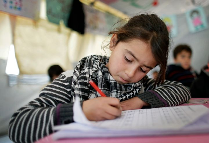 ZAHLE, LEBANON - DECEMBER 09: Girl at a provisional elementary school of an informal tented settlement of Syrian refugees on