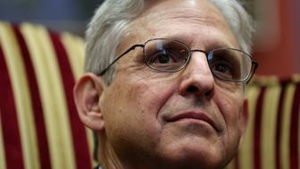 WASHINGTON, DC - APRIL 05:  Supreme Court Justice nominee Merrick Garland listens to questions from reporters while he meets with Sen. Joe Manchin in his office on Capitol Hill April 5, 2016 in Washington, DC. Garland is meeting with senators today while visiting Capitol Hill.  (Photo by Win McNamee/Getty Images)