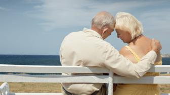 C416AG senior caucasian couple sitting on bench near the sea and hugging. Horizontal shape, rear view, copy space happy; hugging; woman; man; love; couple; elderly; 60s; 70s; adults; affection; aged; bench; carefree; casual; caucasian; copy; space; embracing; emotion; female; future; hug; husband; loving; male; marriage; ocean; old; outdoor; people; persons; relationship; relax; retired; retirement; romance; sea; senior; seniors; serene; sky; smiling; summer; tenderness; together; two; vacations; wife; rear; view; sitting