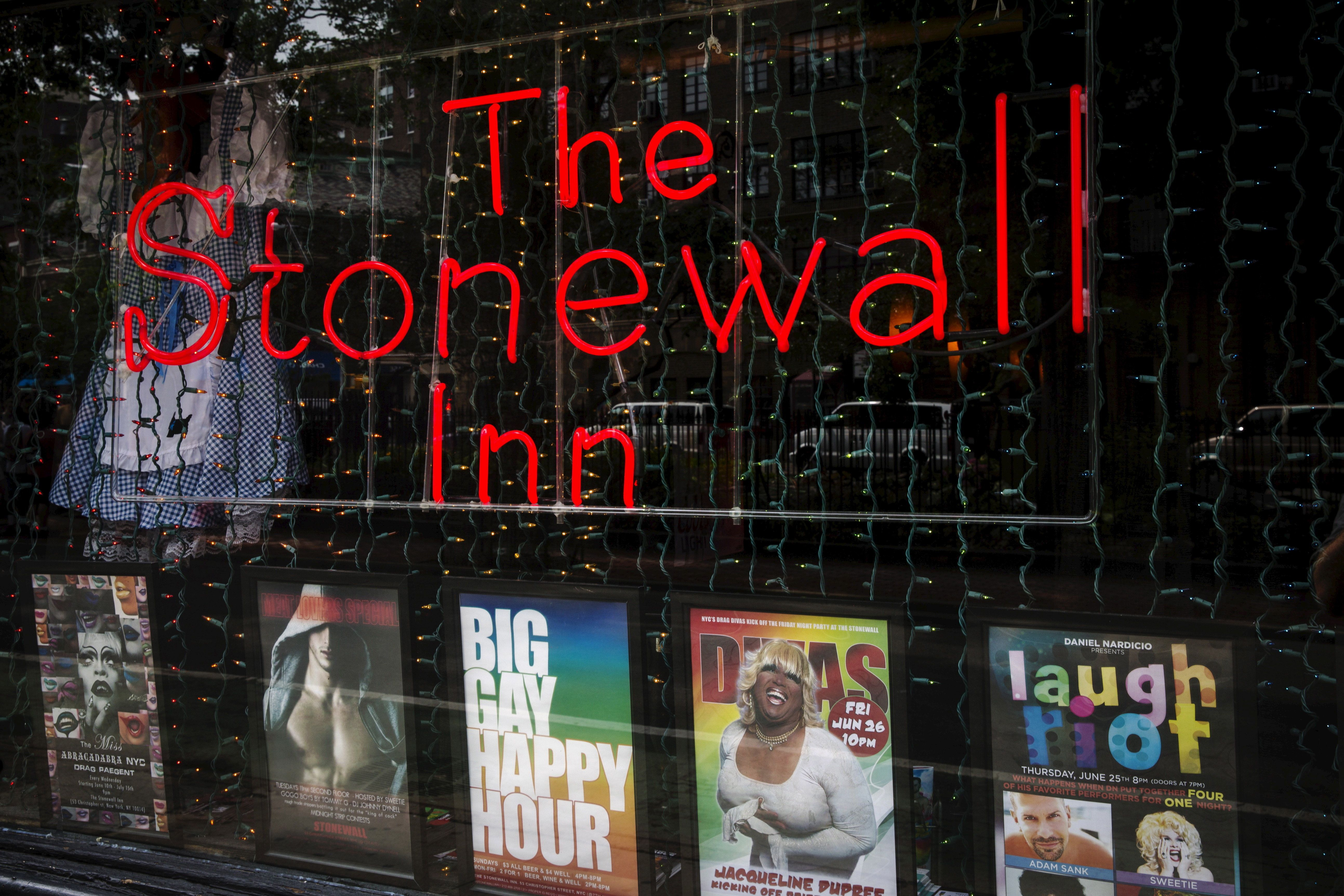 A neon sign shines in the window of the Stonewall Inn in New York, June 23, 2015. The New York City bar that grew into a cultural icon due to its pivotal role in the birth of the gay rights movement, the Stonewall Inn, was granted the historic status of landmark by city officials on Tuesday. REUTERS/Lucas Jackson