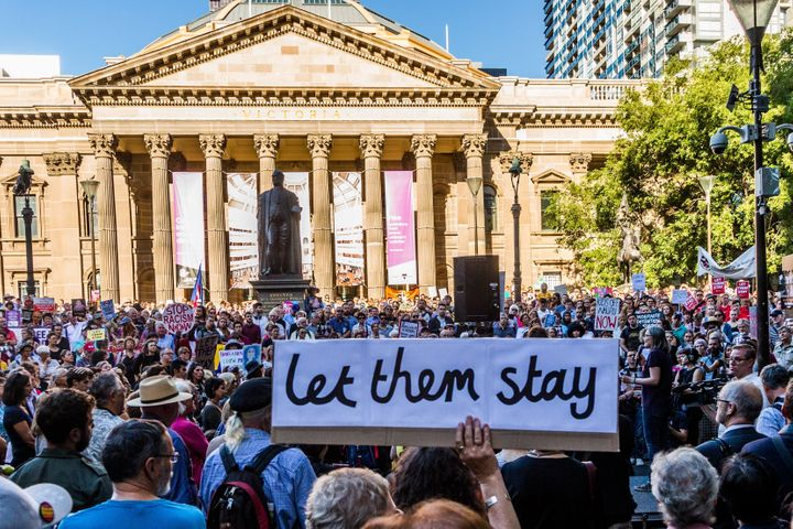 Protestor gather in Melbourne after the High Court of Australia rejected a challenge to the government's right to hold asylum