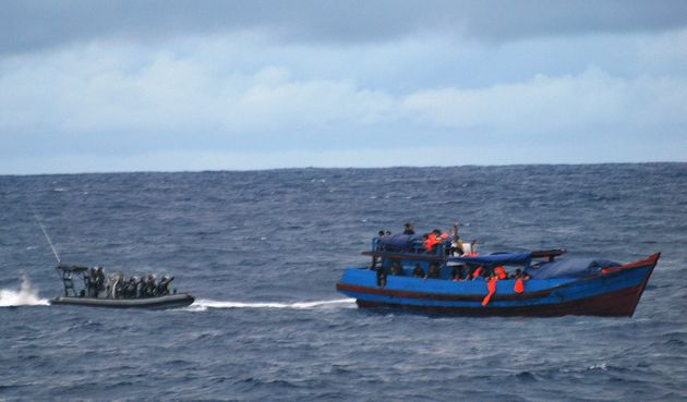 Australia says it is necessary for its navy to intercept migrants' boats, as pictured above in 2010,...