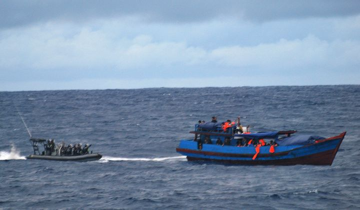 Australia says it is necessary for its navy to intercept migrants' boats, as pictured above in 2010, in order to deter danger