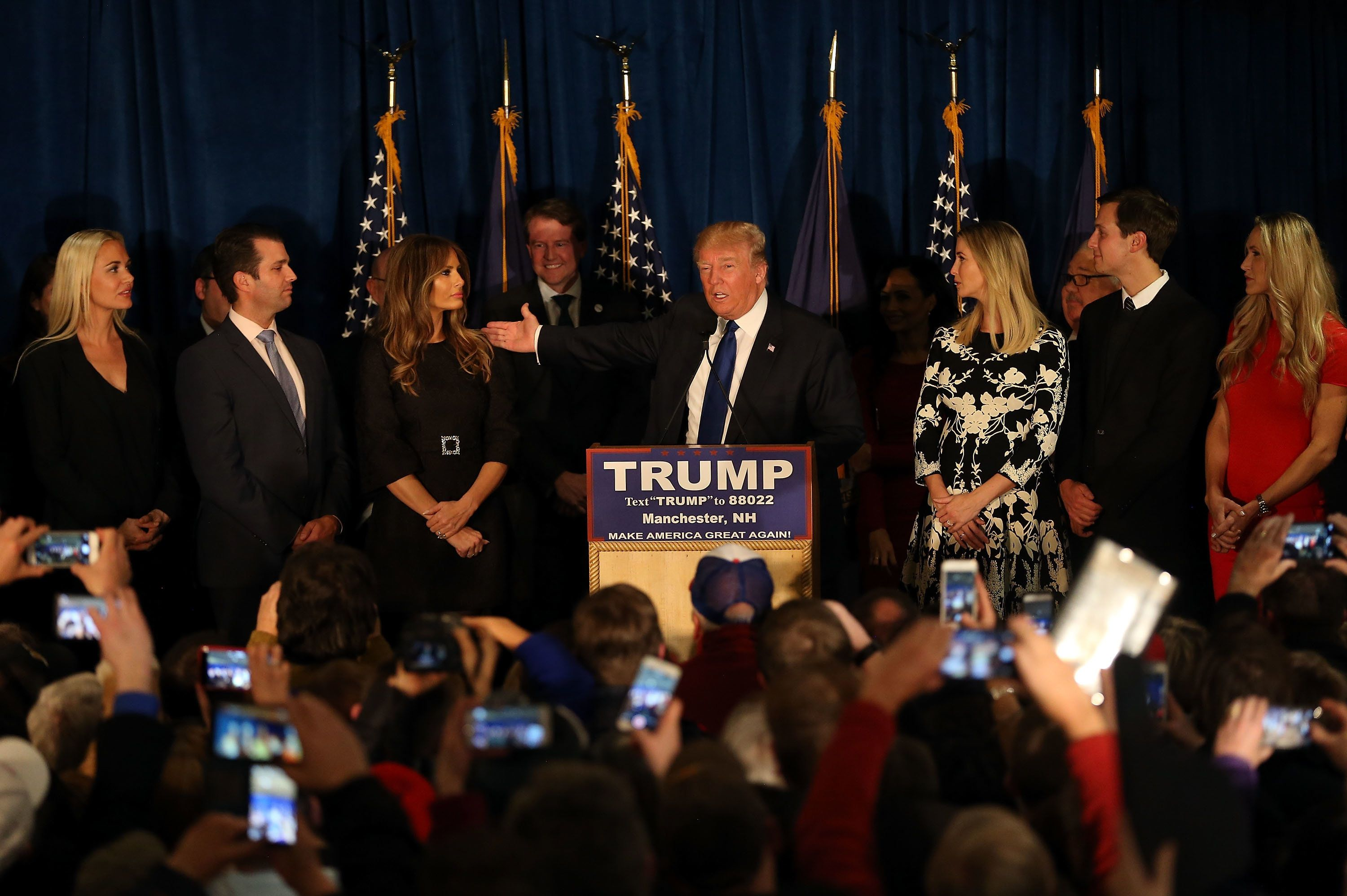 MANCHESTER, NH - FEBRUARY 09:  Republican presidential candidate Donald Trump speaks as his wife  Melania Trump and daughter Ivanka Trump look on after Primary day at his election night watch party at the Executive Court Banquet facility on February 9, 2016 in Manchester, New Hampshire. Trump was projected the Republican winner shortly after the polls closed.  (Photo by Joe Raedle/Getty Images)