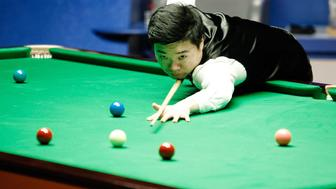 SHEFFIELD, ENGLAND - MAY 02:  (CHINA OUT) Ding Junhui of China plays a shot in the final match against Mark Selby of England on day seventeen of Betfred World Championship 2016 at The Crucible Theatre on May 2, 2016 in Sheffield, England.  (Photo by VCG/VCG via Getty Images)