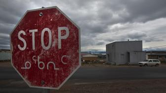 A weathered stop sign in both English and the Inuit language Inuktitut is shown in Iqaluit, Nunavut in the Canadian Arctic August 24, 2009.        REUTERS/Andy Clark     (CANADA SOCIETY)