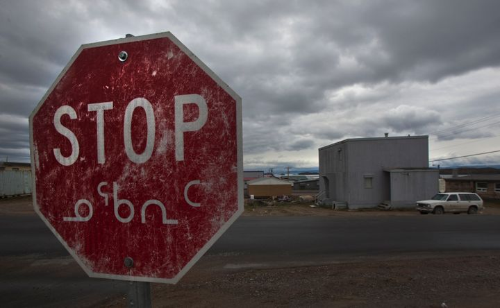 A weathered stop sign in both English and the Inuit language Inuktitut is shown in Iqaluit, Nunavut in the Canadian Arctic.&n