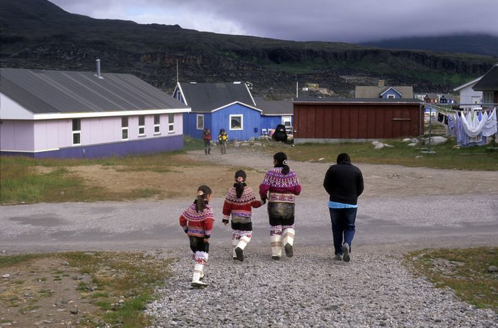 The push to standardize the script has faces resistance from those wary of change. Above, Inuit mother and girls wear traditi