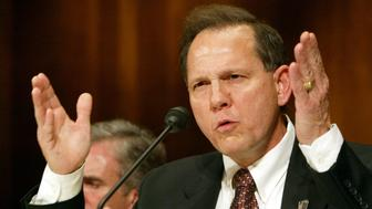 WASHINGTON - JUNE 8:  Roy Moore, former Chief Justice of The Alabama Supreme Court, testifies at a Senate Constitution, Civil Rights and Property Rights Subcommittee hearing, entitled 'Beyond the Pledge of Allegiance: Hostility to Religious Expression in the Public Square.' on Capitol Hill in Washington, DC  June 8, 2004. Moore was removed from office for refusing to take down a public display of the Ten Commandments in the courthouse.  (Photo by Matthew Cavanaugh/Getty Images)