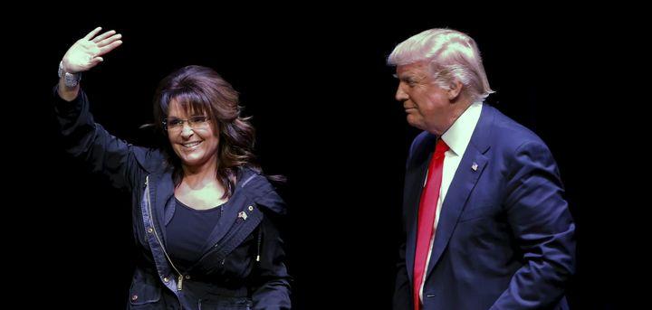 Former Alaska Gov. Sarah Palin (L) introduces Republican U.S. presidential candidate Donald Trump during a town hall on April