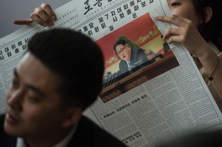 Journalists watch a television broadcast of North Korean leader Kim Jong-Un delivering a speech at the 7th Workers Party Cong