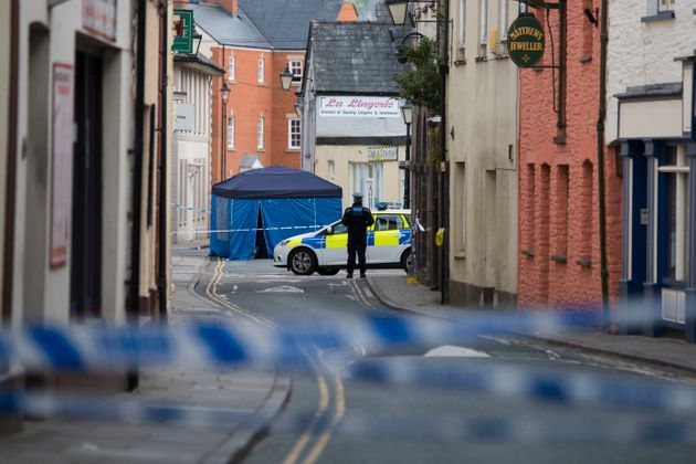 The man was found unconscious and injured in Brecon town