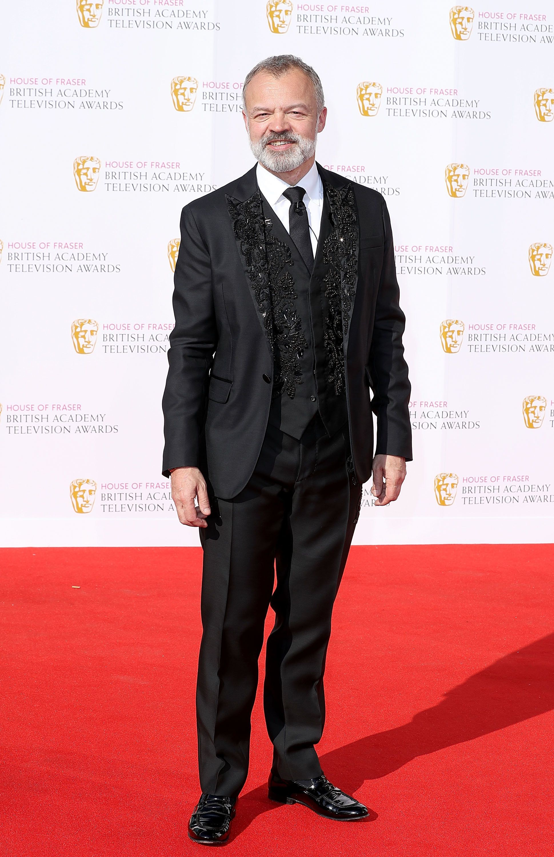 Graham Norton Pulls No Punches With TV BAFTAs Opening