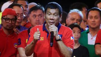 "Philippine presidential candidate and Davao city mayor Rodrigo 'Digong' Duterte gestures during a ""Miting de Avance"" (last political campaign rally) before the national elections at Rizal park in Manila in the Philippines May 7, 2016. REUTERS/Romeo Ranoco"
