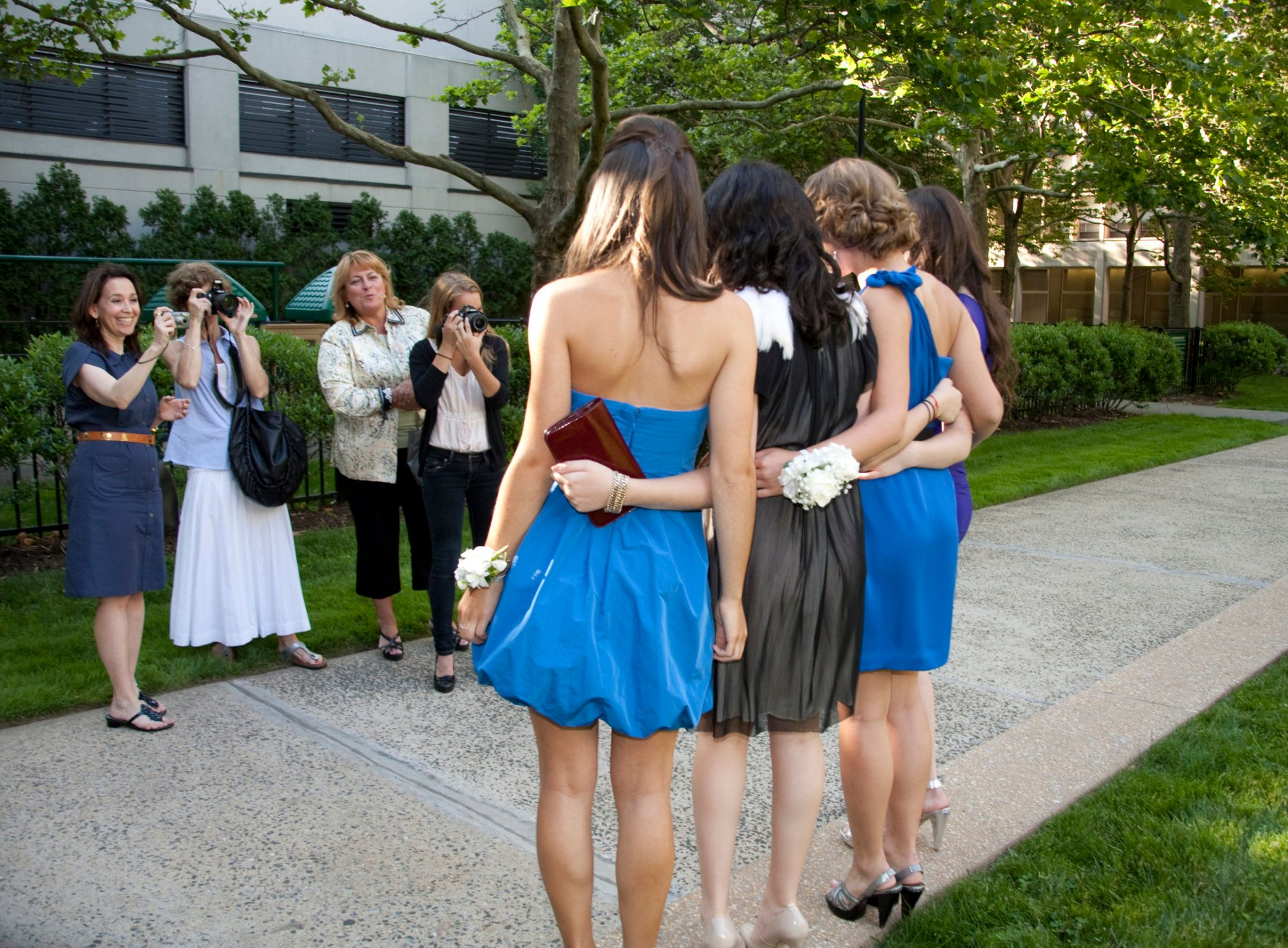 By their mothers and sister before the senior prom.